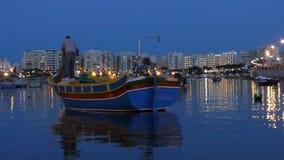 Man in traditional boat in Malta island stock video