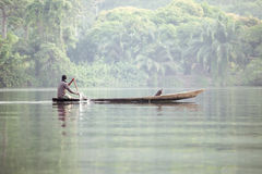Man in Traditional Boat on Tropical River Volta in Ghana, West A stock image