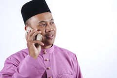 Man in traditional clothing with smartphone celebrate Eid Fitr Royalty Free Stock Image