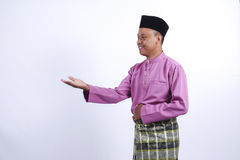 Man in traditional clothing, standing  celebrate Eid Fitr Stock Image