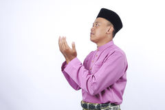 Man in traditional clothing, standing  celebrate Eid Fitr Stock Photos