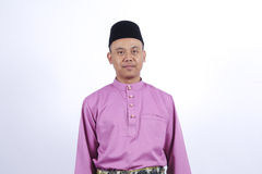 Man in traditional clothing, standing  celebrate Eid Fitr Royalty Free Stock Photo