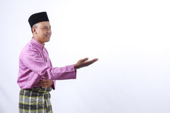 Man in traditional clothing, standing  celebrate Eid Fitr Royalty Free Stock Photos