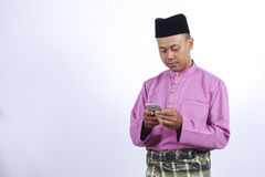Man in traditional clothing, standing  celebrate Eid Fitr Stock Images