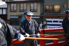 Man with traditional dress drags majestic floats Royalty Free Stock Photography