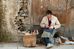 Man and traditional hand tools Royalty Free Stock Photos