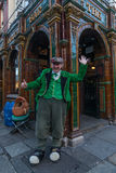 Man in traditional Irish clothes performing at The Quays Bar Stock Photo