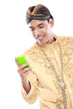 Man with traditional java suit using mobile phone Royalty Free Stock Images