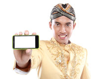 Man with traditional java suit using mobile phone Royalty Free Stock Photography