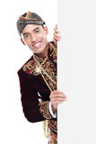 Man with traditional suit of java Royalty Free Stock Images