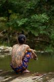 Man with traditional thai sak yant tattoos squats near hot springs royalty free stock photos