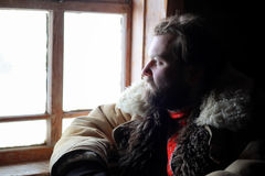 Man in traditional winter costume of peasant medieval age in rus Royalty Free Stock Images