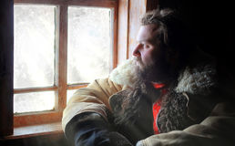 Man in traditional winter costume of peasant medieval age in rus Royalty Free Stock Photos