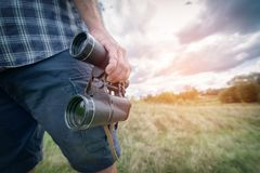 Man on the trail holding binoculars Stock Image