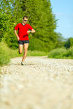 Man trail running on country road Stock Photo