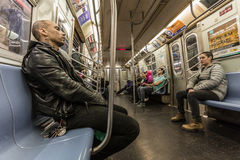 Man on train rides New York City Subway late election night, November 9, 2016 Stock Photography