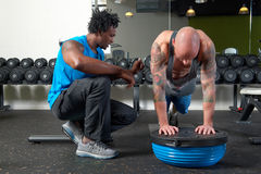 Man with trainer in gym Royalty Free Stock Photography