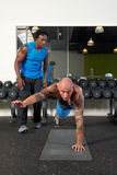 Man with trainer in gym Royalty Free Stock Photo