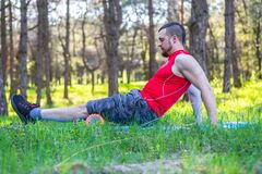 Man trainer showing exercises on the foam roller, the free space. stock photo