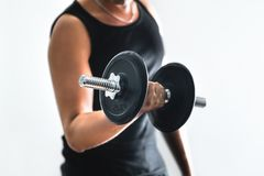 Man training arms and doing bicep curls with dumbbell royalty free stock photography