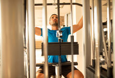 Man training chest and back muscles at the gym Royalty Free Stock Photography