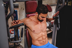 Man training on the chest machine Royalty Free Stock Images