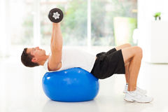 Man training dumbbells Stock Images