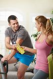 Man training on exercise bike Stock Images