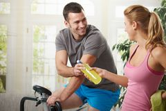 Man training on exercise bike Stock Photos