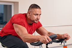 Man training on exercise bike Royalty Free Stock Image