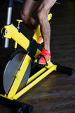 Man training on exercise bike Royalty Free Stock Photos