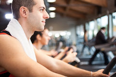 Man training in a fitness club Stock Images