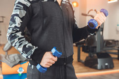 Man training in gym body health fit care. Male training in gym body workout with dumbbells Stock Images