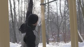 Man training gym exercise on winter sports ground. Sport training concept. Handsome man training gym exercise on winter sports ground. Sport man doing workout on stock video
