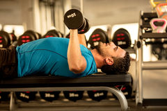 Man training in a gym Stock Image
