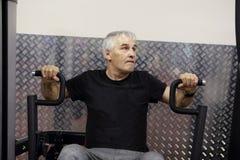 Man training in gym Stock Image