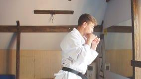 Man training karate in gym. Slow motion stock video