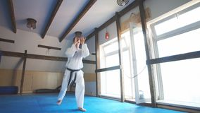 Man training karate in gym. Young man training karate, sport and fitness at gym stock footage