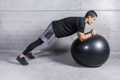 Man training with medicine ball royalty free stock photo