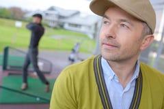 Man training at mini golf stock images