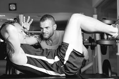 Man training with personal trainer Stock Images