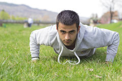 Man training push ups Stock Photos