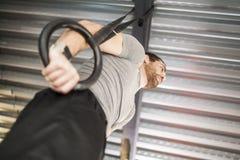 Man training rings stock photos