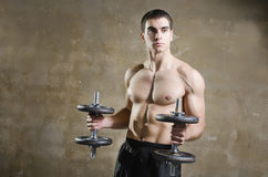 Man training shouder muscles exercises in old gym Stock Images