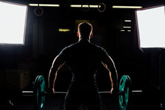 Man training squats with barbells over head. Royalty Free Stock Photography