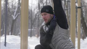Man training stretching exercise with fitness expander on outdoor training stock video