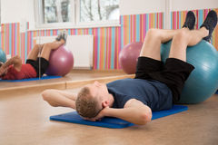 Man training with swiss ball Stock Image