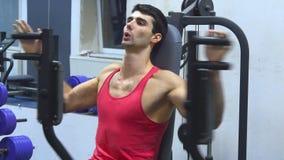 Man training on training apparatus stock video footage