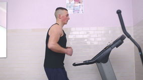 Man training on a treadmill. In a gym stock video footage