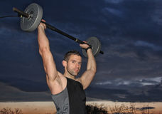 Man training with weight Royalty Free Stock Image
